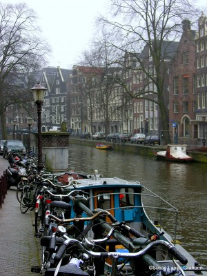 Bikes along an Amsterdam canal. Bikes are part of the culture in Amsterdam. Remember when you visit that bikes have the right-of-way on the streets. Rent one and see the streets like a local.