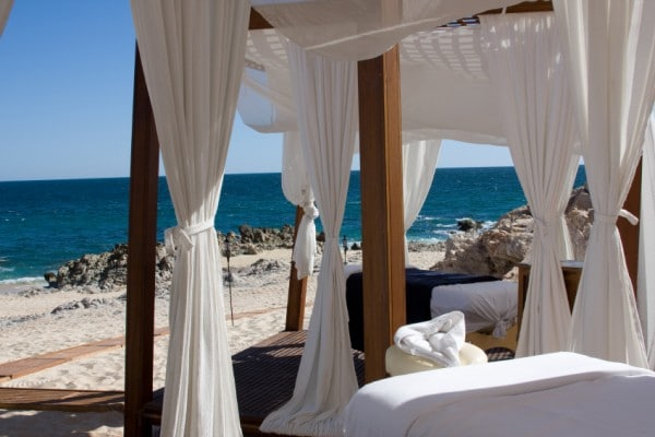 Massage tables await on a tranquil beach in Mexico.
