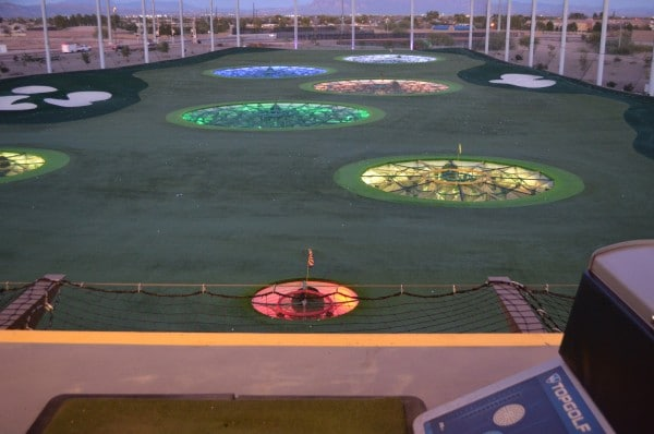 Topgolf putting green at night